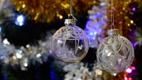 Colorful glowing christmas balls on the tree Royalty Free Stock Photography