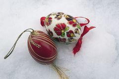 Nice colorful easter egg on the snow Stock Images