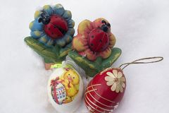 Nice colorful easter egg on the snow stock photography