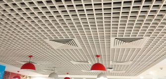 Beautiful designed with squares interior ceiling. royalty free stock image