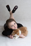 Very nice girl holds a red kitten Royalty Free Stock Photos