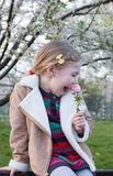 Very nice girl under a cherry feels good Royalty Free Stock Images