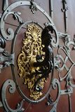 Very nice historical doorknocker. As nice architecture detail Stock Photography