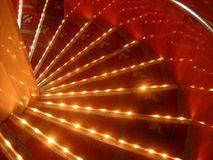 Very nice lit up spiral stares. Very cool red and gold spiral stares that are lit up with yellow lights Royalty Free Stock Image