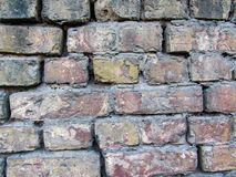 Very nice brick wall background: close-up of natural old vintage weathered light brown not plastered solid brick wall royalty free stock photos