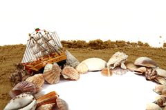 Sand frame with the shells and boat Royalty Free Stock Image