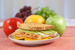 Very nice served picnic sandwich. Sandwich plate perfect made with fruits on back Stock Photography