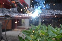 Sparks from digging the gates in my garden stock photos