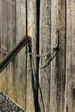 Wooden wall and chain lock Stock Photo