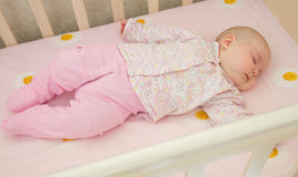 Very nice sweet baby sleeping in crib. At home Royalty Free Stock Photography