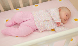 Very nice sweet baby sleeping in crib Royalty Free Stock Photos