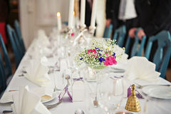 A very nicely decorated wedding table with plates and serviettes. Royalty Free Stock Images