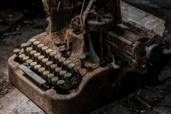 Vintage typewriter very rusty and dirty stock photo