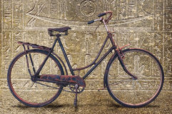 A very old bicycle inside an egyptian tomb Royalty Free Stock Image