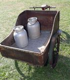 Very old bike used once a long time ago from the milkman with bi. Old bike with milk canister used once a long time ago from the milkman to deliver the fresh Stock Images