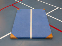 Very old blue mat on a blue court Royalty Free Stock Image