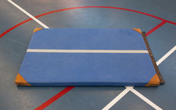 Very old blue mat on a blue court Stock Image