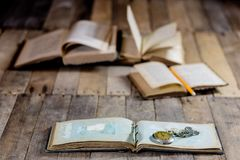 Very old book and key on an old wooden table. Old room, wooden t Royalty Free Stock Image