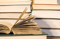 A very old book resting on book. More books in the background Royalty Free Stock Photo