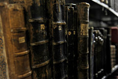 Very old books on a shelf in archive room Royalty Free Stock Photography