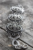 Very old bracelet. On a wooden background, Shallow depth of field Royalty Free Stock Photos