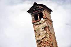 Very old brick smoking chimney Stock Image