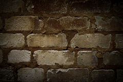 Very old brick wall. Covered with brown patina Stock Images