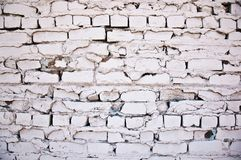 Very Old Brick Wall. Painted white in a downtown alley Royalty Free Stock Photo