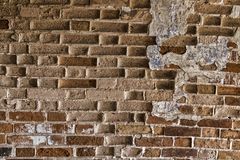 Very old brickwork. Very old masonry made of red brick. Wall with fallen off plaster Stock Images