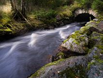 A very old bridge. In streaming water Royalty Free Stock Image