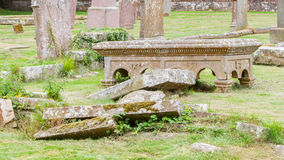 Very old broken gravestone in the cemetery Royalty Free Stock Photo