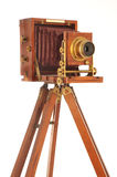 Very Old Camera. On a wooden tripod on a white background stock photography