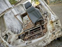 Very Old car. This is an old car which is worn and torn and corroded due to exposure to continuous seasonal torture Stock Photos