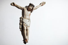 Very old carved and painted wooden crucifix Stock Images