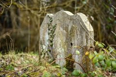 Very old cemetary. Aged stone stock photo