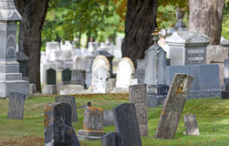 Old cemetery with leaning tombstones Royalty Free Stock Image