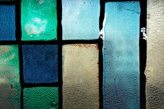 Very old crannied stained glass window Royalty Free Stock Photography