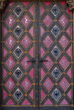 Very old decorated exterior doors Stock Image