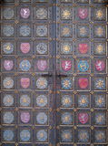 Very old decorated exterior doors. Very old richly decorated exterior doors of St. Peter and Paul Basilica at Prague. The ornaments show symbolic Czech Lion and royalty free stock photography