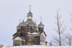 Very old domed catholic church. Extremely weathered Ukrainian Catholic Church on a snowy hill Royalty Free Stock Images