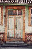 Very old door. Old dirty brown wooden door, on white background Stock Photography