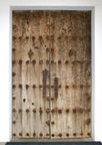 A very old door in Mexico. An old double door with heavy brass nails and hasp Royalty Free Stock Photos