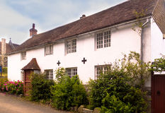 A Very Old English Country Cottage. Situated in the heart of a very old village in England, this cottage is one of many. These pretty cottages often date back to Royalty Free Stock Images