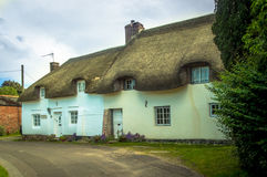 A Very Old English, Thatched, Country Cottage. Situated in the heart of a very old village in England, this cottage is one of many. These pretty cottages often Stock Photo