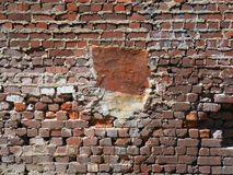 Exposed Old Brickwork With Rough Mortared Joints. Very old exposed brickwork with rough bulging mortar between joints royalty free stock photos