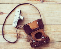 Very old film camera on brown wooden background Stock Photography
