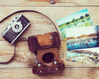 Very old film camera and old foto. Stock Image