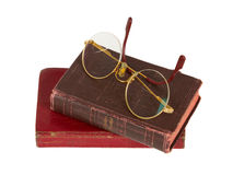 Very old glasses and books isolated Stock Photo