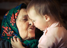 Very old grandmother with granddaughter Stock Image