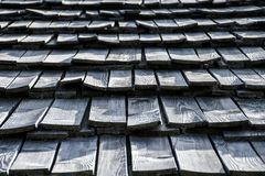 Very old grey curved wooden shingle roof texture royalty free stock photos